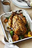 roast chicken in baking tray on table
