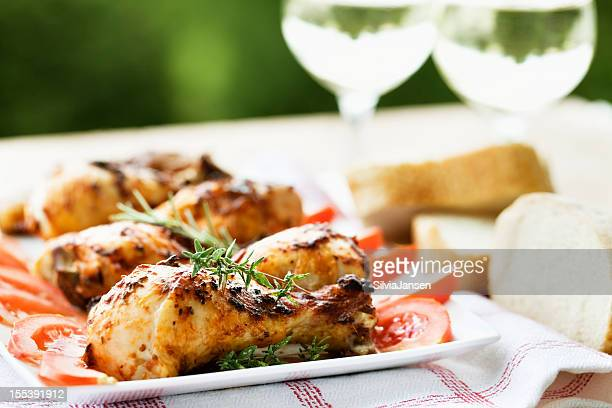 roast chicken legs and white wine at picnic