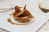 Roast chicken on plate with demi-glaze