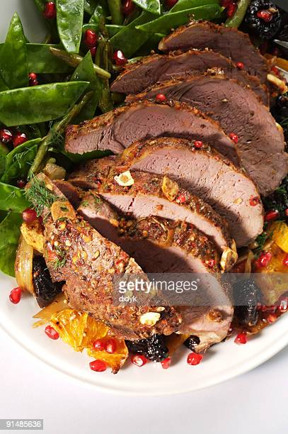 A roast cooked Christmas lamb on a white plays