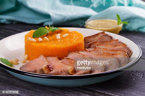 Roast duck breast and pumpkin mash : Stock Photo