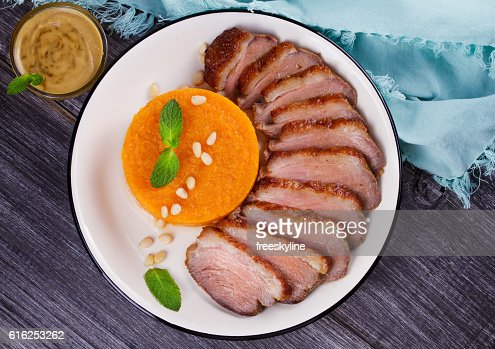 Roast duck breast and pumpkin mash : Stock Photo