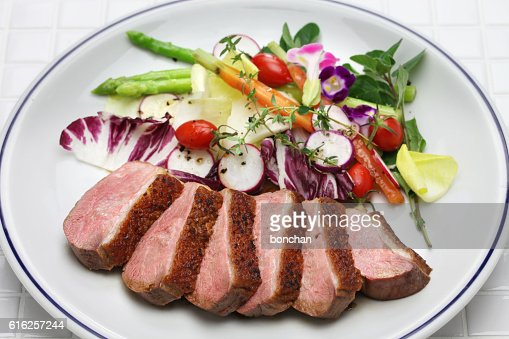 roast duck breast with vegetables : Stock Photo