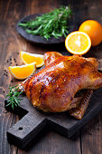 Roast duck in orange glaze, selective focus