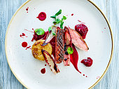 Roast Duck with beetroot sauce with fried potatoes and beetroot chunks