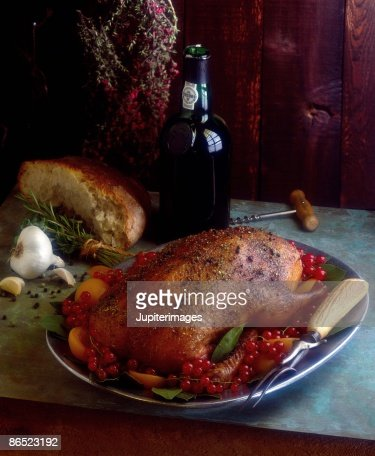 Roast duck with currants : Stock Photo