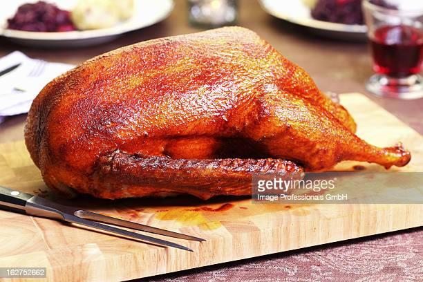 Roast goose on chopping board