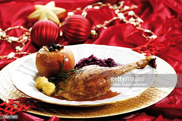 Roasted goose on plate and Christmas decoration