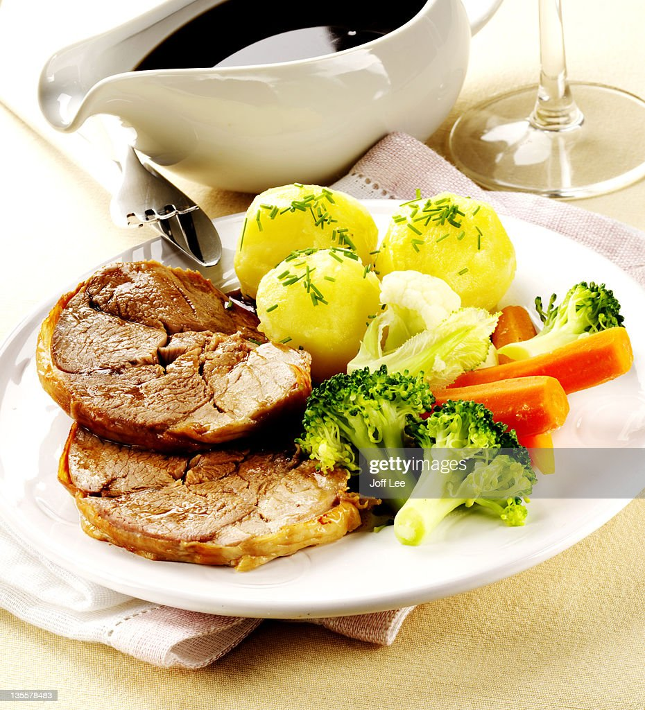 Roast lamb with vegetables & gravy boat
