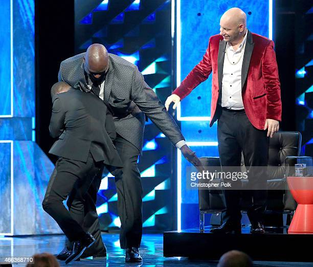 Roast master Kevin Hart TV personality/retired basketball player Shaquille O'Neal and comedian Jeffrey Ross attend The Comedy Central Roast of Justin...