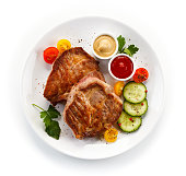 Roast ham and vegetables on white background