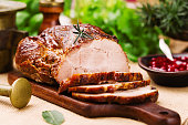 Roast pork with cranberry dip, basil, coriander and rosemary.