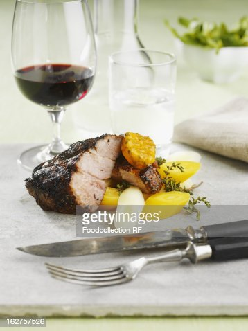 Roast Pork With Root Vegetables And Red Wine Stock Photo | Getty ...