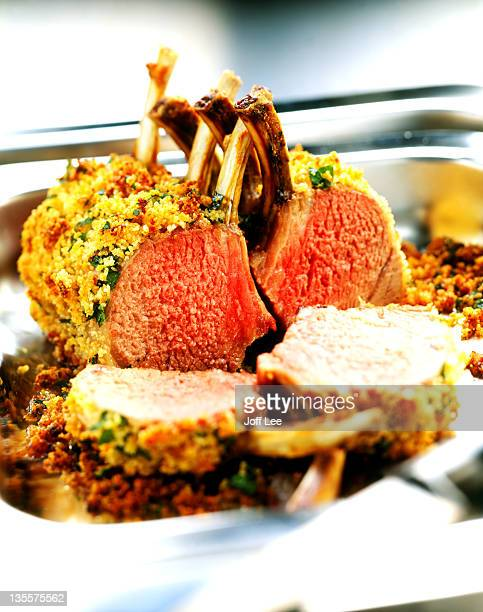 Roast rack of lamb - cut to show pink meat