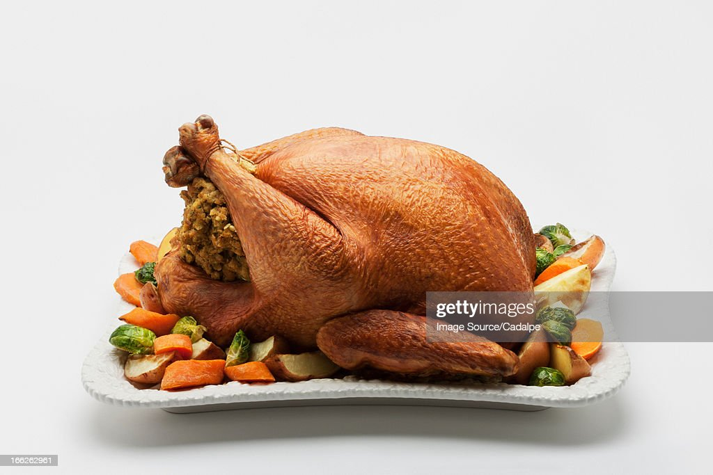 Roast stuffed chicken with vegetables : Stock Photo