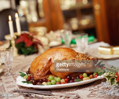 Roast turkey on dinner table : Bildbanksbilder