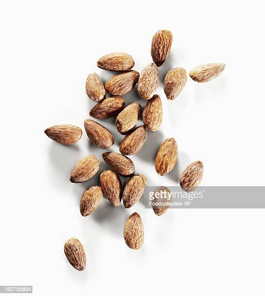Roasted almonds on white background