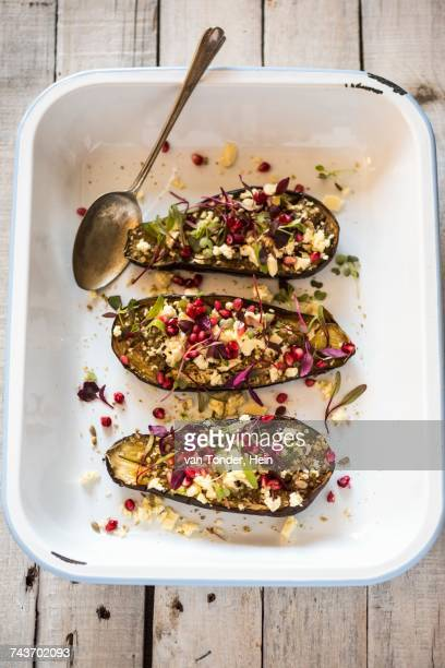 Roasted aubergines with feta cheese and pomegranate seeds