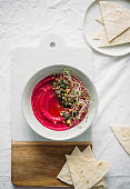 Roasted Beet Hummus in a ceramic bowl