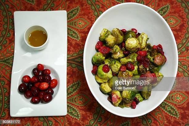 TORONTO ON DECEMBER 9 roasted Brussels sprouts and cranberries from Homegrown Celebrating the Canadian Foods We Grow Raise and Produce is a...