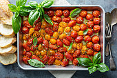 Roasted cherry tomatoes with herbs and olive oil