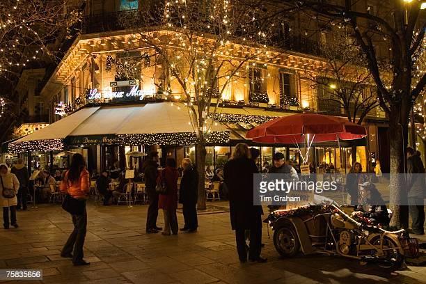 Roasted chestnut street seller outside Les Deux Magots Cafe and Restaurant Boulevard St Germain Paris France