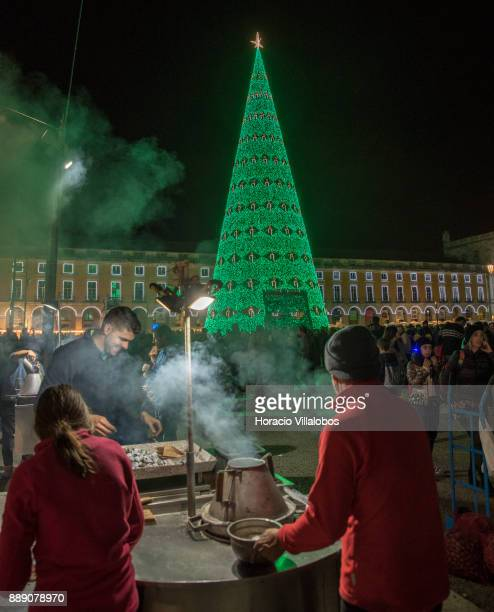 Roasted chestnuts stall near the large Christmas tree and Christmas and New Year light displays in Praca do Comercio on December 9 2017 in Lisbon...