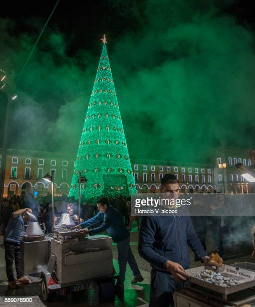 Roasted chestnuts stalls near the large Christmas tree and Christmas and New Year light displays in Praca do Comercio on December 9 2017 in Lisbon...