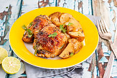 Roasted Chicken Thighs Served with Lemon