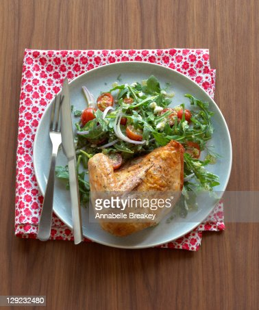 Roasted Chicken with Arugula Tomato Salad : Stock Photo