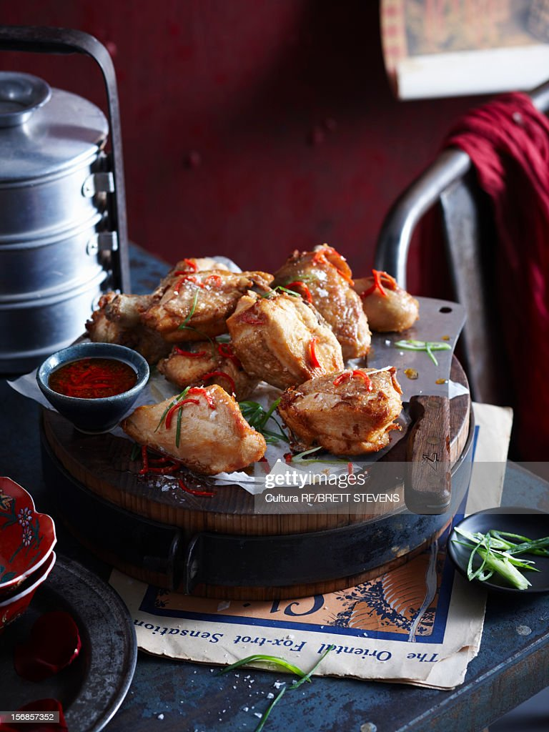 Roasted chicken with onion and sauce : Stock Photo