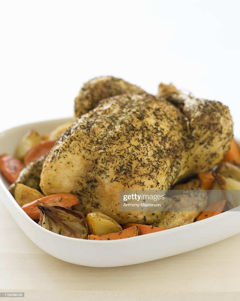 Roasted chicken with root vegetables : Stock Photo