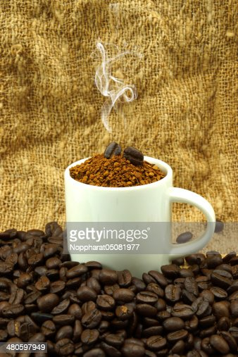 Roasted coffee beans. And instant coffee. : Stock Photo