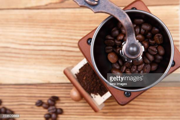 Roasted coffee beans in coffee grinder