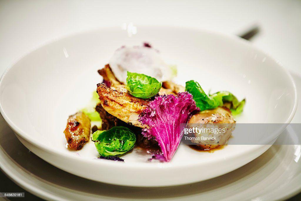 Roasted Cornish game hen with brussels sprouts