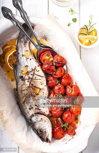 Roasted fish with tomatoes and herbs