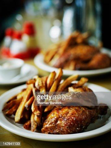 Roasted free range chicken, fried potatoes : Stock Photo