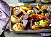 Roasted fruits and vegetables on wooden table
