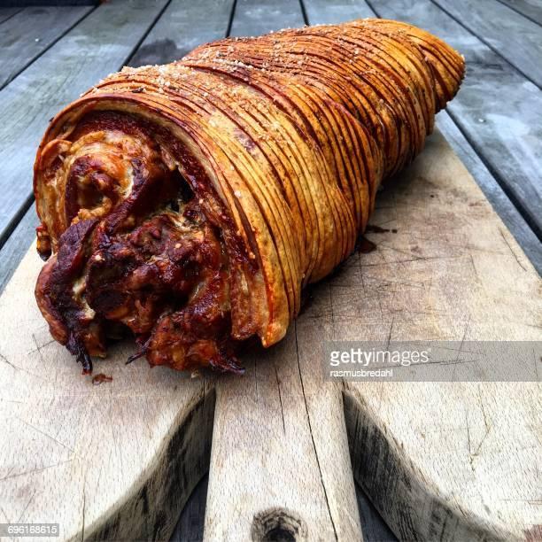 Roasted porchetta on a chopping board