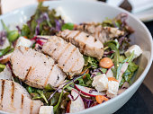 Roasted pork with mixed vegetable salad and cheese