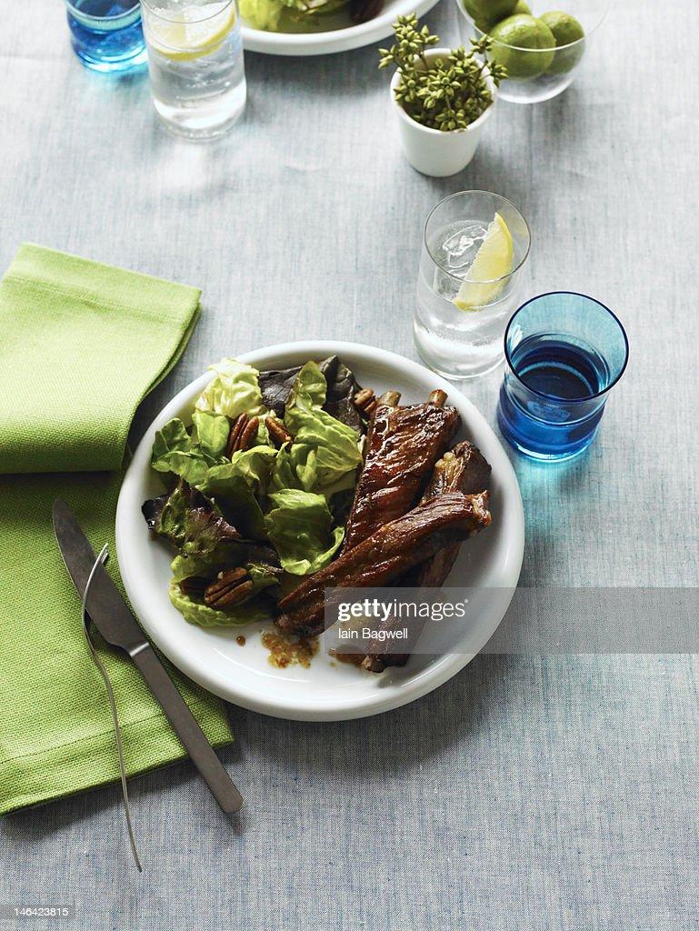 Roasted pork spareribs & pecan salad : Stock Photo