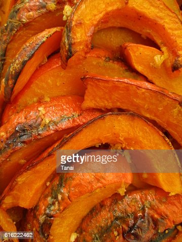 Roasted pumpkin slices, closeup : Stock Photo