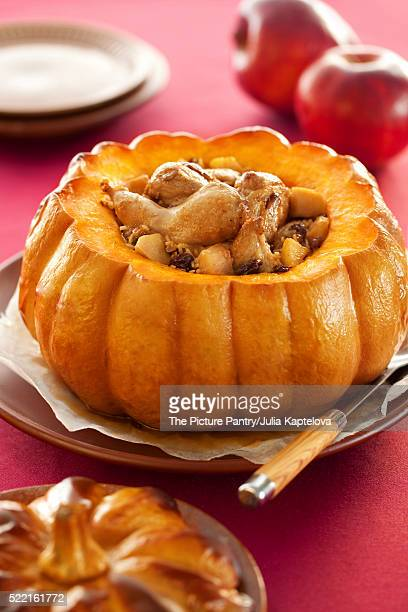 Roasted pumpkin stuffed with rabbit and rice