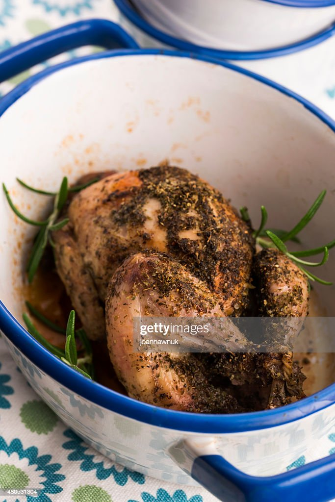 Roasted quail with herbs : Stock Photo