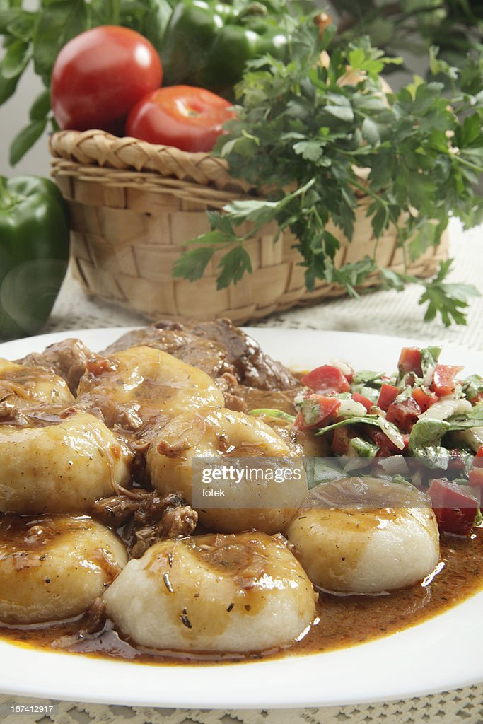 Roasted shoulder with dumplings : Stock Photo