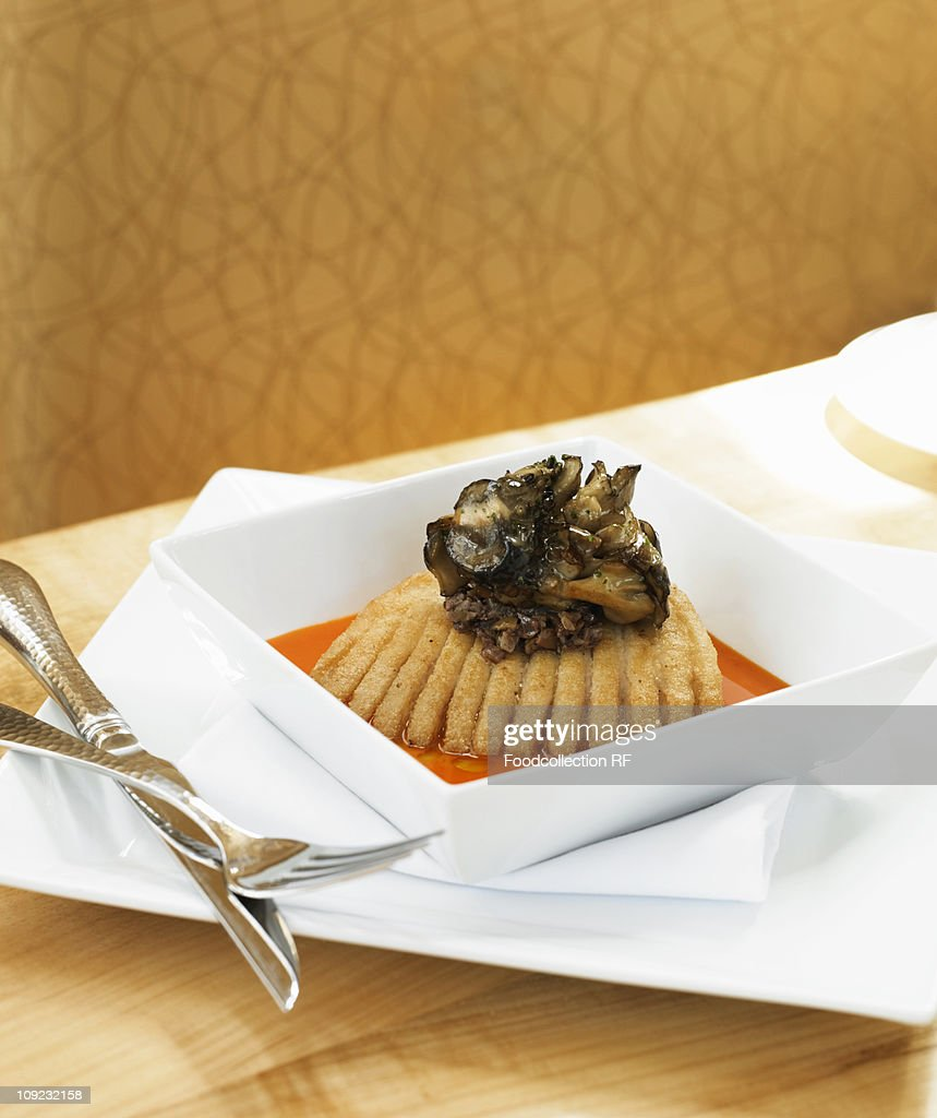 Roasted skate fish with bell pepper sauce in bowl : Stock Photo