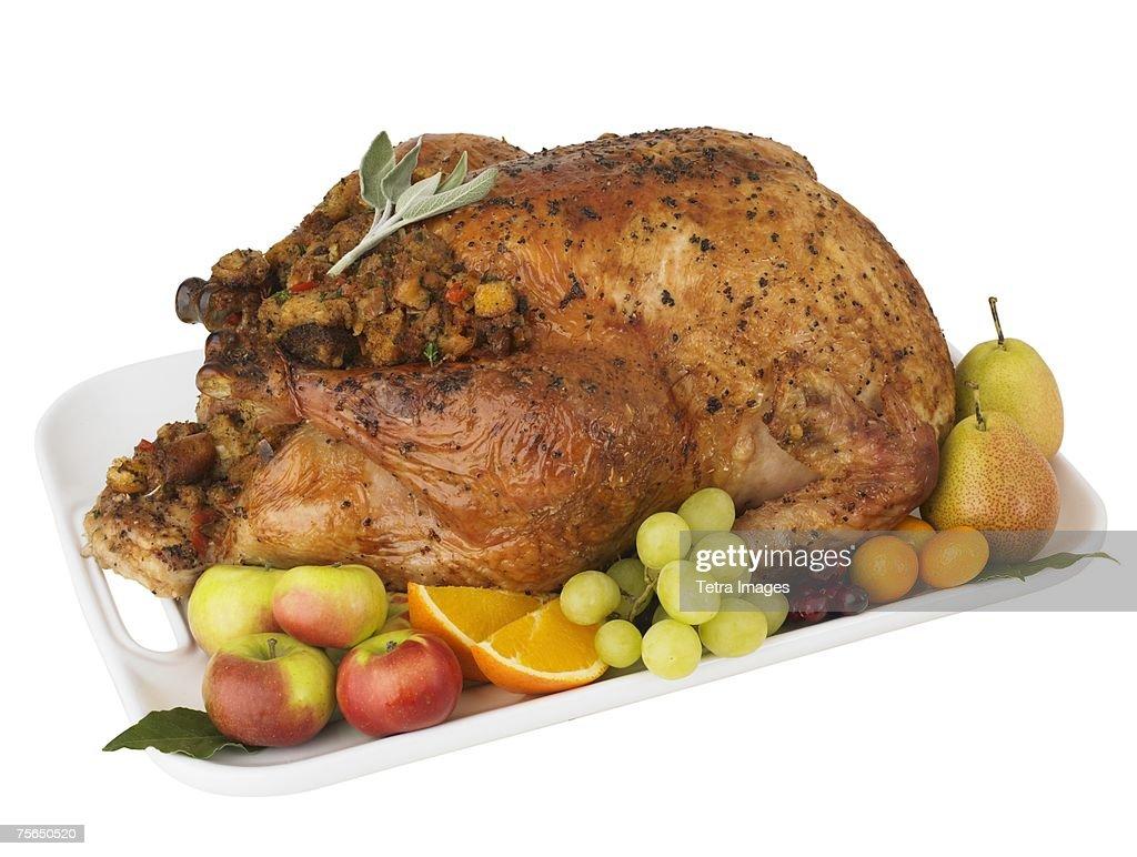 Roasted turkey and fruit on platter