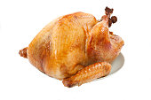 Mouth-watering golden roasted turkey over white background, no garnish.