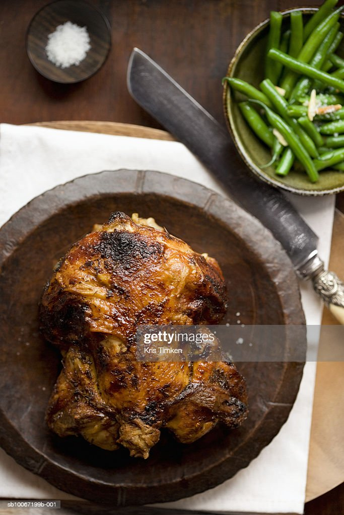 Roasted whole chicken with salt and green beans