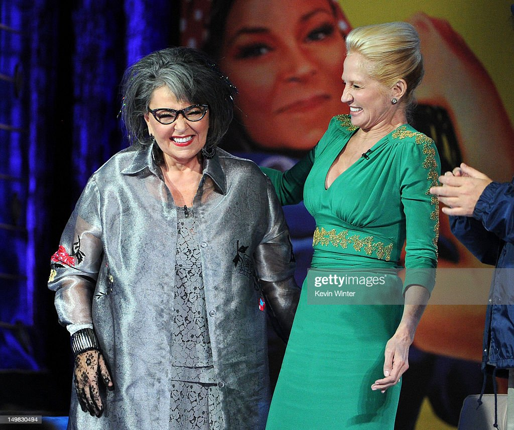 Roastee Roseanne Barr and actress Ellen Barkin speak onstage during the Comedy Central Roast of Roseanne Barr at Hollywood Palladium on August 4, 2012 in Hollywood, California.
